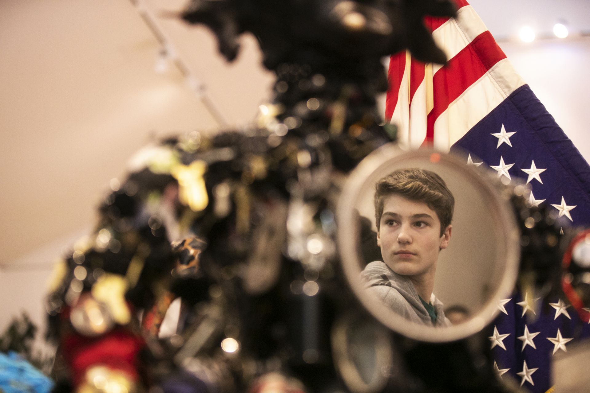 Lewiston Middle School student Michael Caron, 13, is seen in a reflection from a mirror while visiting the Bates Museum of Art on February 5, 2020.