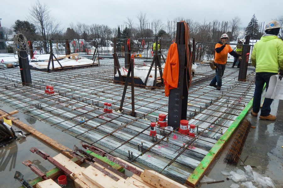 A scene from the second floor of the Bonney center on Feb. 10. A concrete slab will soon conceal the rebar and decking on the floor. (Doug Hubley/Bates College)