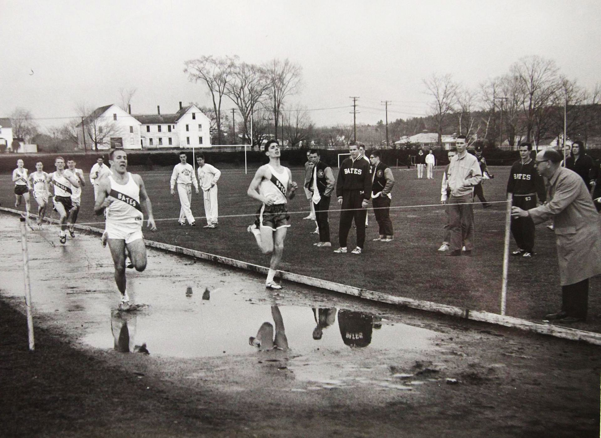 In the 1950s, the impervious clay beneath Bates helped to make Garcelon Field's old cinder track puddle-prone. (Courtesy Tom Leonard '78)