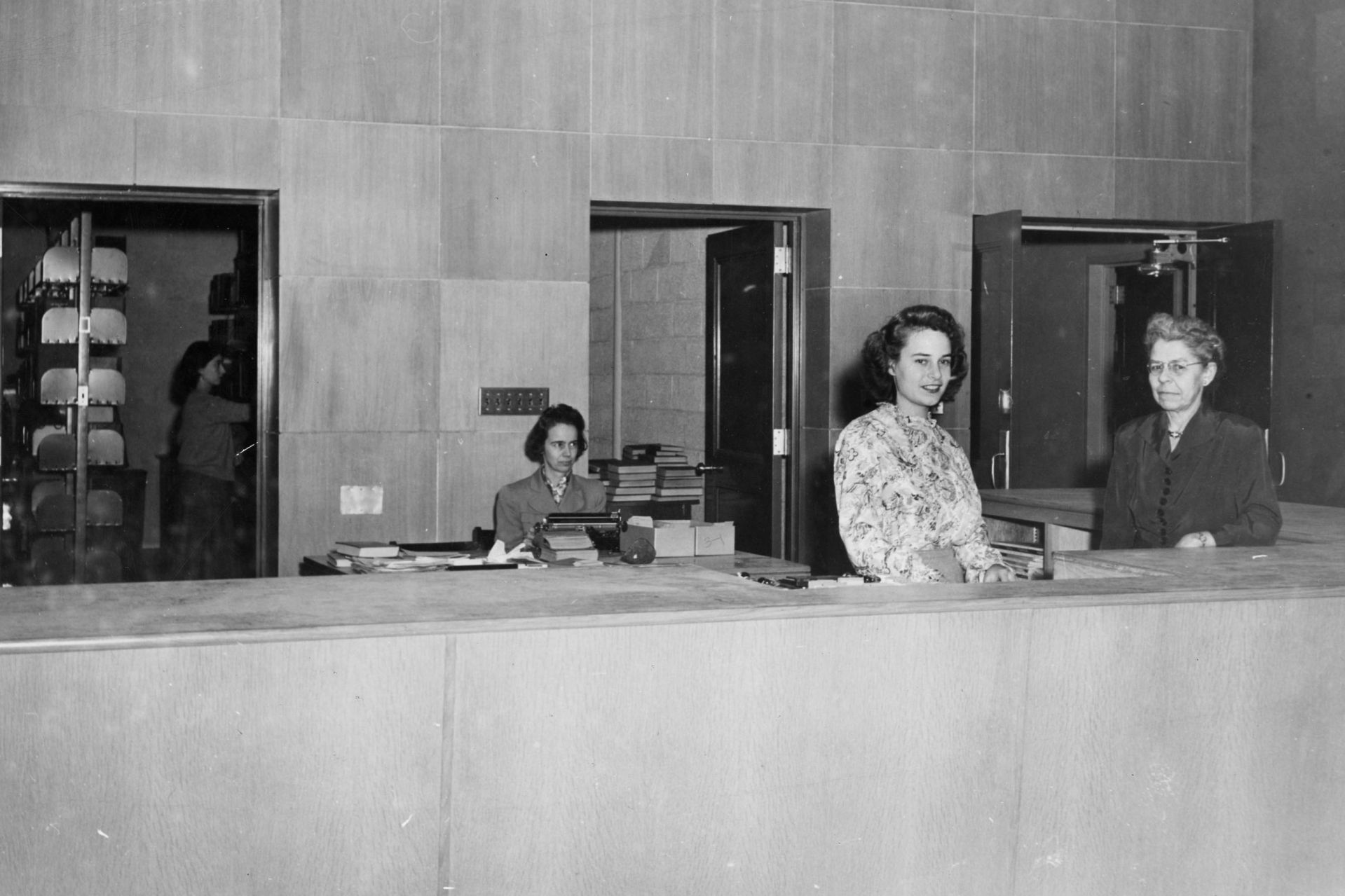 The staff of Coram Library in 1946, from left:, Elizabeth Stoneham, Assistant Librarian Iva Foster '30, student worker Jeannette Packard Stewart '46, and librarian Mabel Eaton, Class of 1910. (Muskie Archives and Special Collections Library)