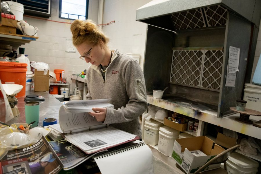 Olin Arts CenterTalia Binns '20 protects her lungs with a mask as she mixes creamics glazes in the ceramics kitchen adjacent to the kiln.