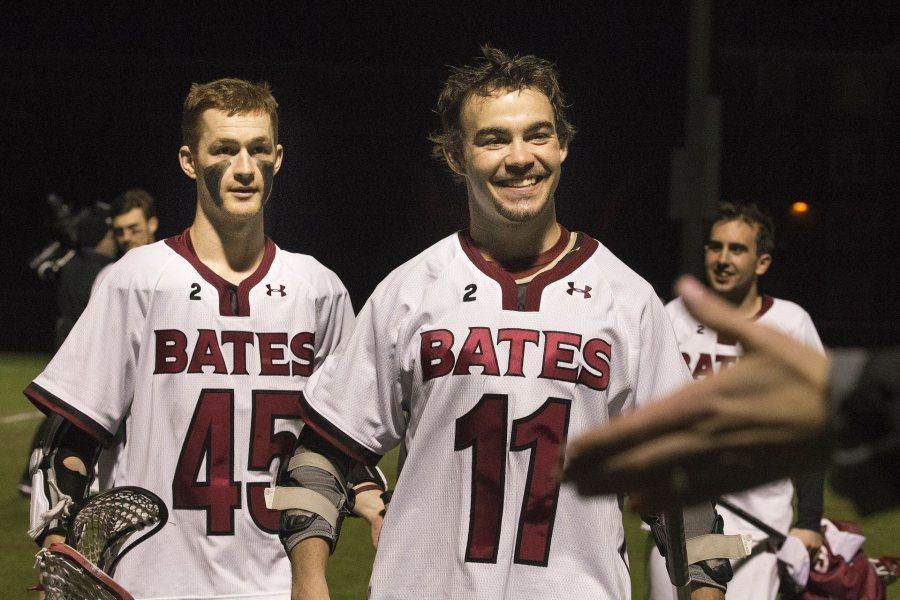 Jack Allard '16 (left) and classmate Charlie Hildebrand celebrate a big Bates lacrosse win over Tufts in April 2016. (Phyllis Graber Jensen/Bates College)