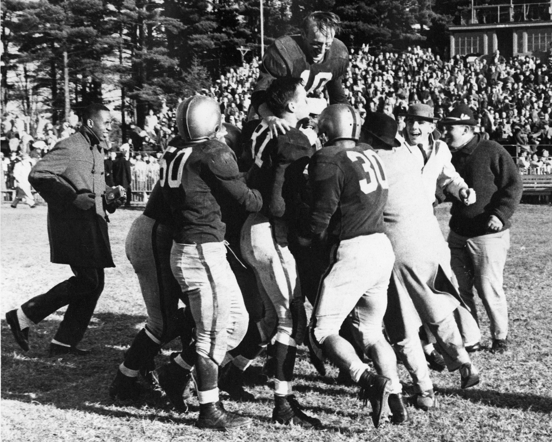 Mostly avoiding the flu, the Bates football team defeated the University of Maine on Oct. 26, 1957. (Muskie Archives and Special Collections Library)