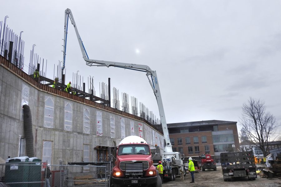The pumper places concrete for a section of third-story wall on the Bonney center's south face on March 23. (Jay Burns/Bates College)