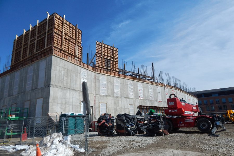 Seen from Nichols Street on March 25, Symons concrete forms are appearing for the west and  south third-story walls of the Bonney Science Center. (Doug Hubley/Bates College)