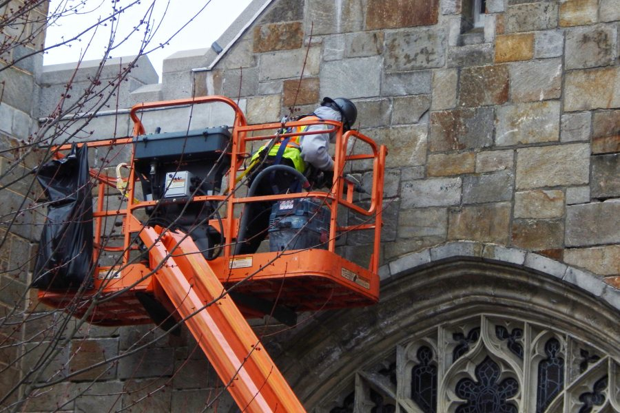 With masonry repairs  complete on the east and west exterior walls of the Gomes Chapel, the emphasis has shifted to the north (shown) and south walls. (Doug Hubley/Bates College)