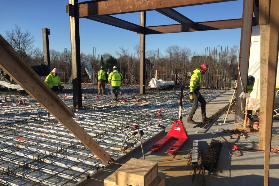 Final preparations are underway just before concrete flows to complete the third-story floor slab at the Bonney building. (Jacob Kendall/Bates College)