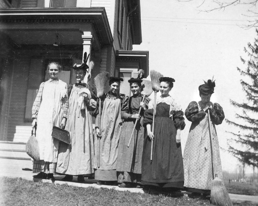 Circa 1897, members of the Class of 1897 pose outside Cheney House: Mary Buzzell, Margaret Knowles, Emma Chase, Mabel Winn, Anna Snell, Caroline Cobb.