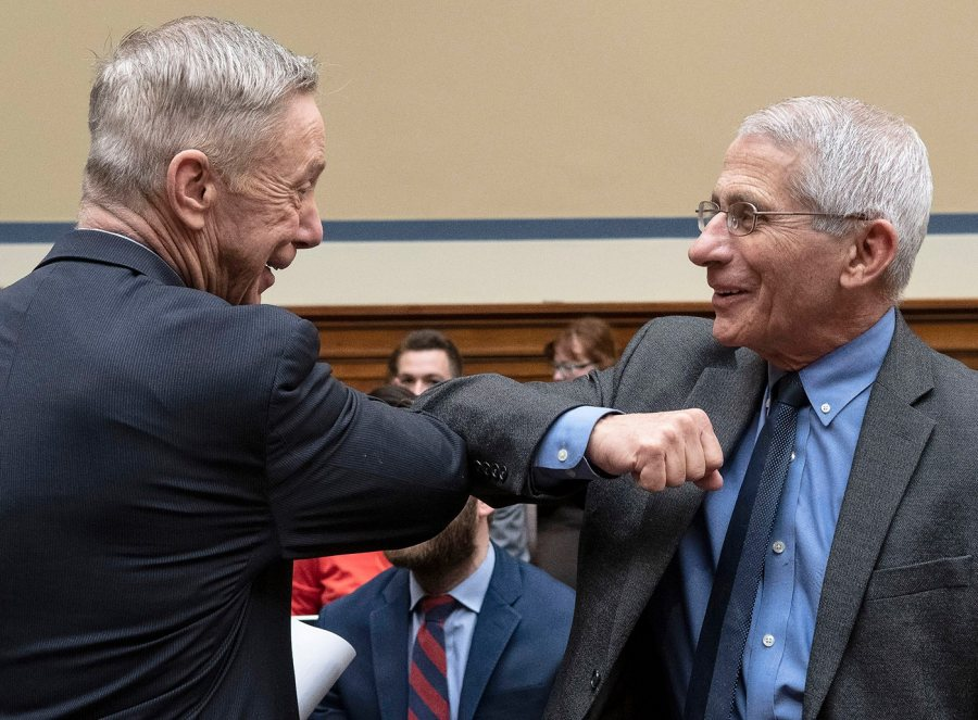 Dr. Anthony Fauci, director of the Institute of Allergy and Infectious Diseases at the National Institutes of Health, gives an elbow-bump greeting to Rep. Stephen Lynch, D-Mass., before a House Committee on Oversight and Reform hearing on the coronavirus situation, March 11, 2020, on Capitol Hill. (Joe Gromelski '74 / Stars and Stripes)