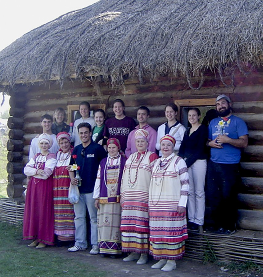 "Costlow poses with her students in 2006 in front of the ""coachman's cottage"" on Tolstoy's estate, Yasnaya Polyana, near Tula. The folk ensemble had just performed. (Courtesy Jane Costlow)"