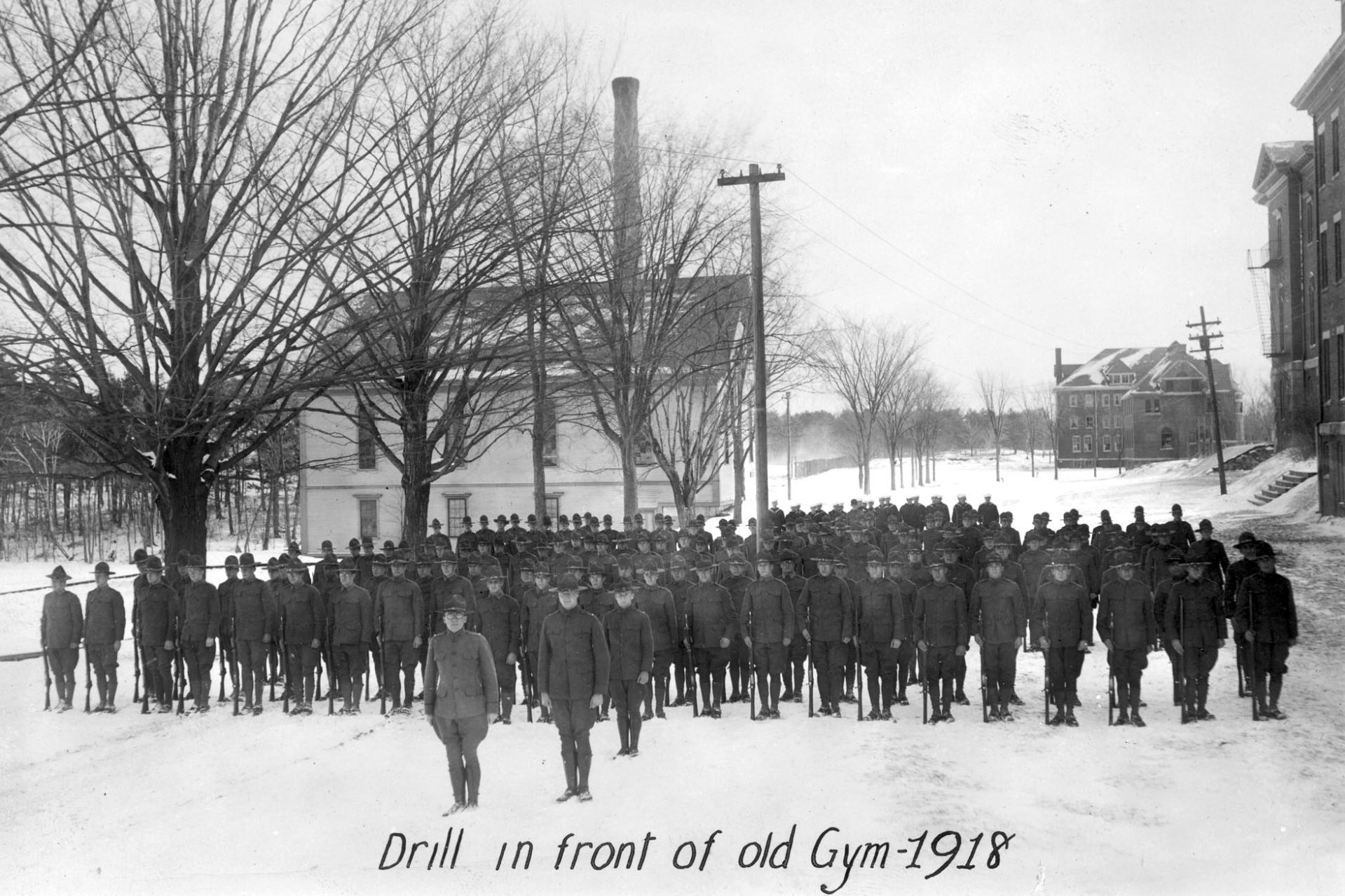 Members of the Student Army Training Corps go through drills in 1918 behind Hathorn Hall. The old wood-frame gym is at left. (Muskie Archives and Special Collections Library)