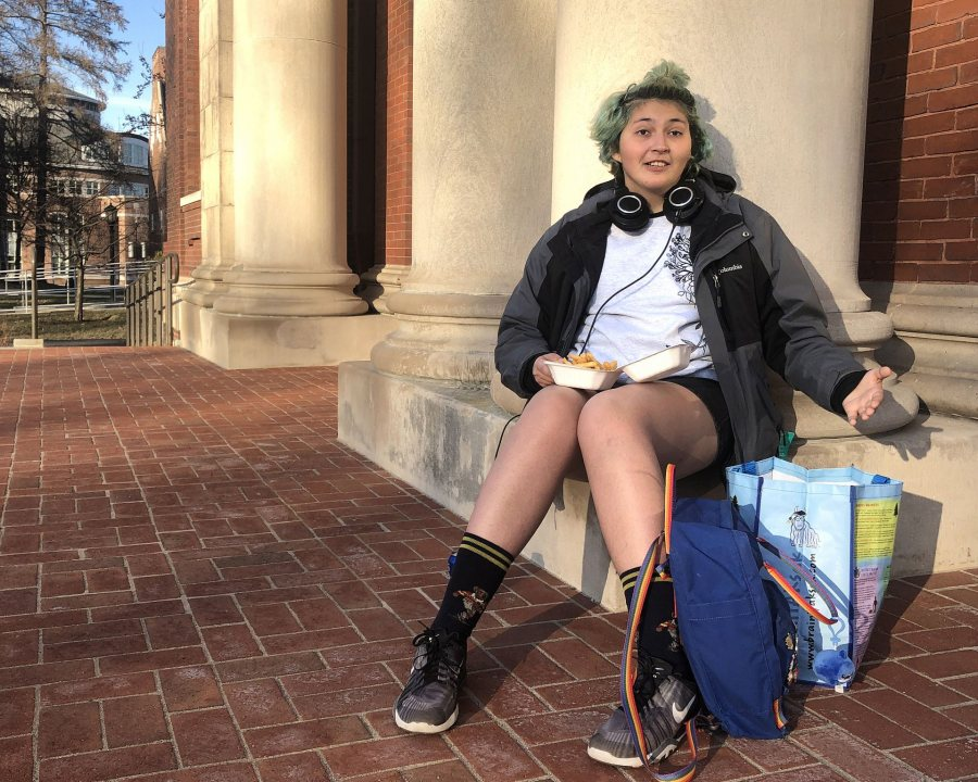 """""""I like just taking time to sit out here and get some fresh air."""" On a warm April afternoon, Alexis Fifield '21 of Guatemala City, Guatelema, finishes dinner, including some comfort food, french fries."""