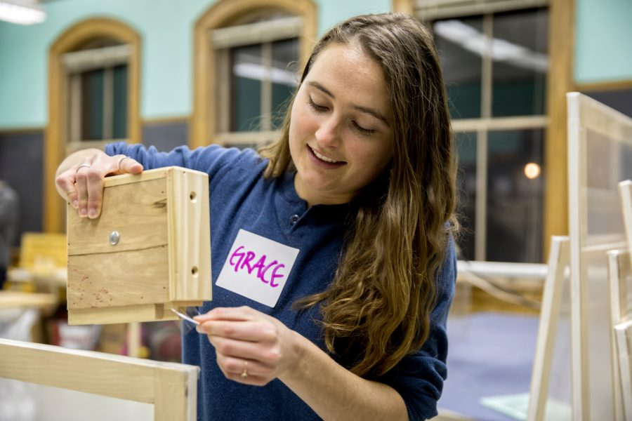 Awarded this year for community engagement, Grace Ellrodt takes part in a 2018 Window Dressers workshop in Lewiston. Window Dressers is a Maine nonprofit that brings volunteers together to produce low-cost insulating window inserts that help retain heat in homes. (Phyllis Graber Jensen/Bates College)