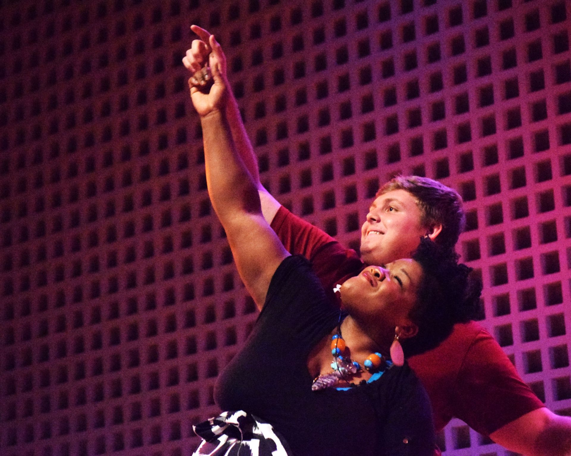 "Interacting with her audience, Vanessa German does a few dance steps with Nicholas Florio '22 during her talk in Olin Arts Center on Oct. 25, 2019, celebrating the opening of ""Miracles and Glory Abound"" in the Bates Museum of Art. (Photograph by Vanessa Paolella '21)"