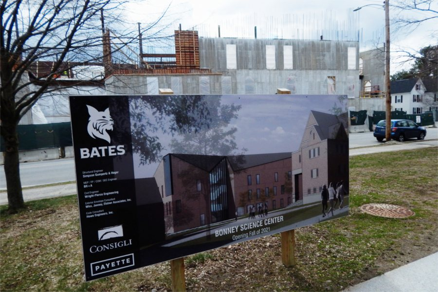 Shown on April 15, 2020, is an architect's rendering of the Bonney Science Center with the real item in the background. (Doug Hubley/Bates College)