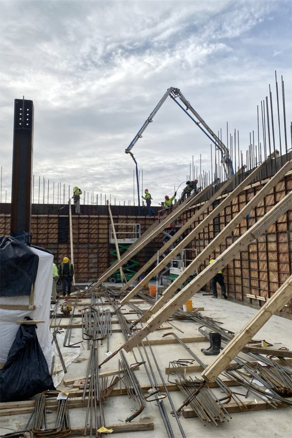 The concrete pump fills a section of third-level wall on April 24. (Geoff Swift/Bates College)