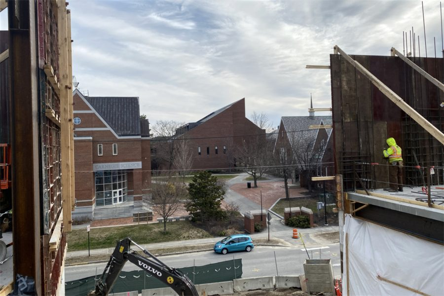 """A view of (from left) Carnegie Science Hall, Ladd Library, and Chase Hall, seen from the third floor of the Bonney Science Center. This gap in the exterior wall will be the location of the """"monumental stairs,"""" a visual highlight of the new building. (Geoff Swift/Bates College)"""