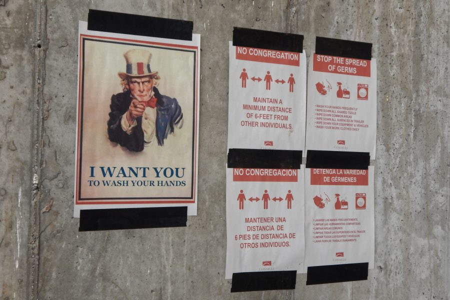 Signs of the times at the Bonney building worksite. (Doug Hubley/Bates College)