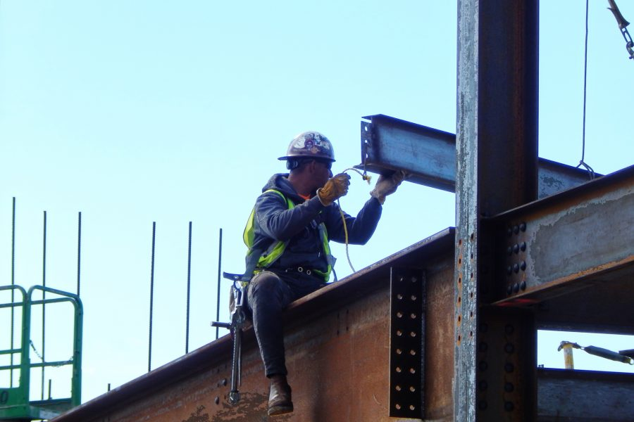 Receiving a girder that will support the penthouse floor of the Bonney Science Center. (Doug Hubley/Bates College)