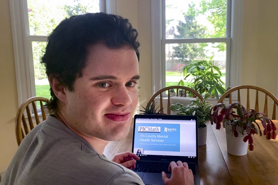 "Jason Canaday 20, a student in Adriana Salerno's ""PIC Math: Topics in Industrial Mathematics"" course, at home in Wellesley, Mass., where he has been doing work for the course on his laptop in his bedroom and the family kitchen."