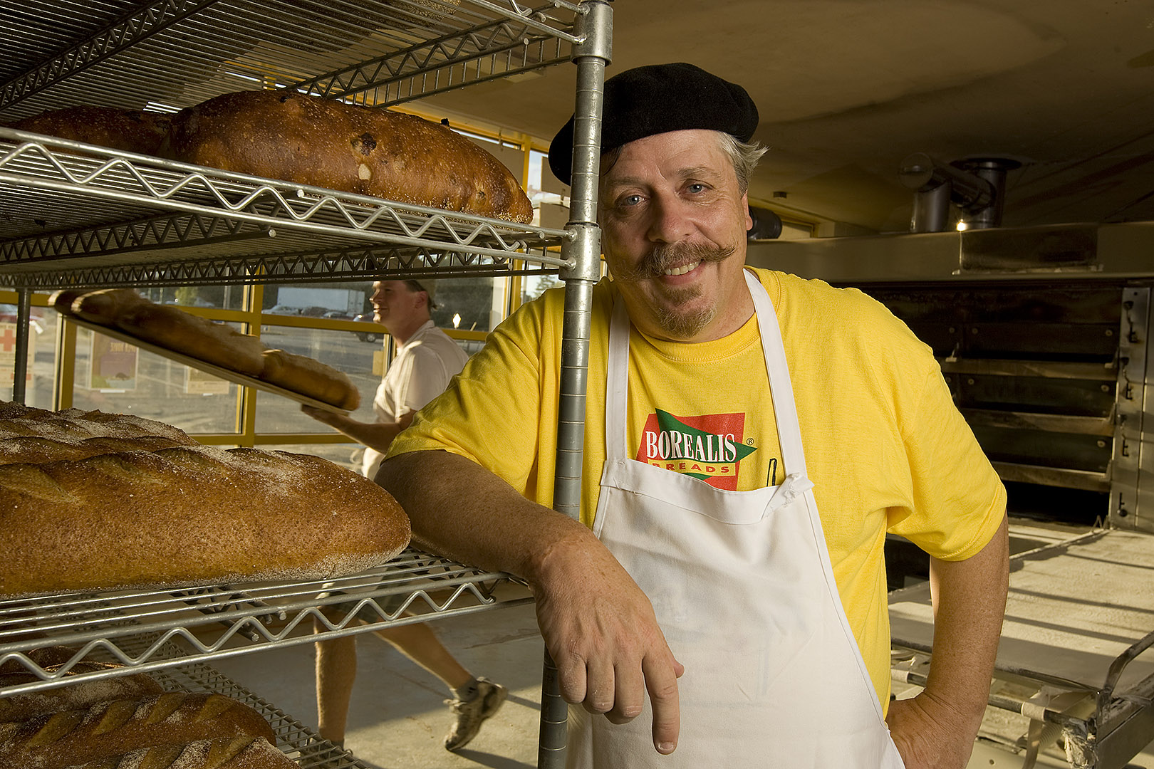 James Amaral '80, president and founder of Borealis Breads, poses and works at 1165 Post Road (Rte 1) in Wells, one of the two locations for his company (the other is in Waldoboro). The Wells store includes retail and baking facilities, as well as the company's offices.