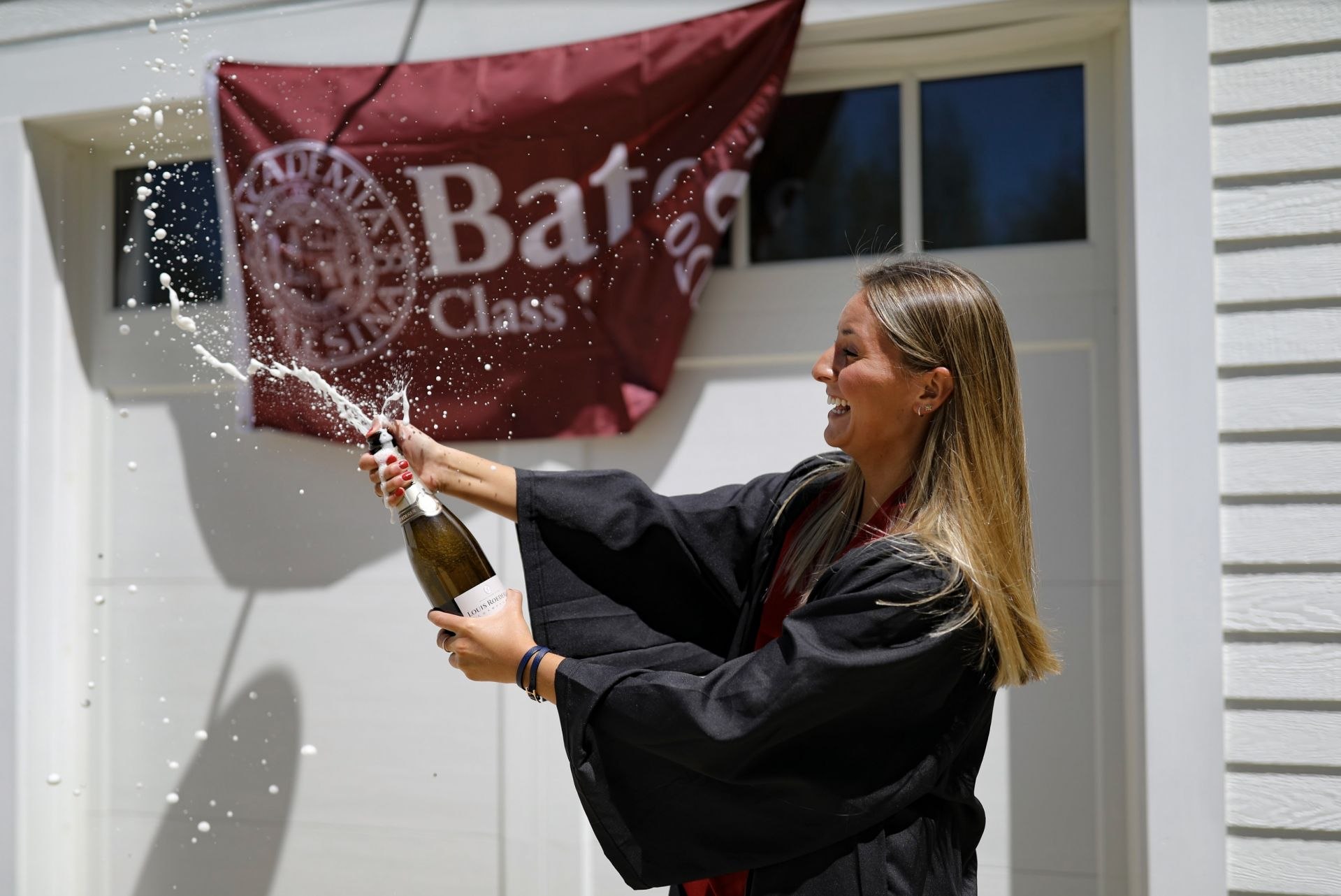 Scenes from Commencement Day, May 31, 2020. Anna Glass '20 of Wilton, Maine, celebrates at home with her parents, Marc and Wendy Glass .@berglicht
