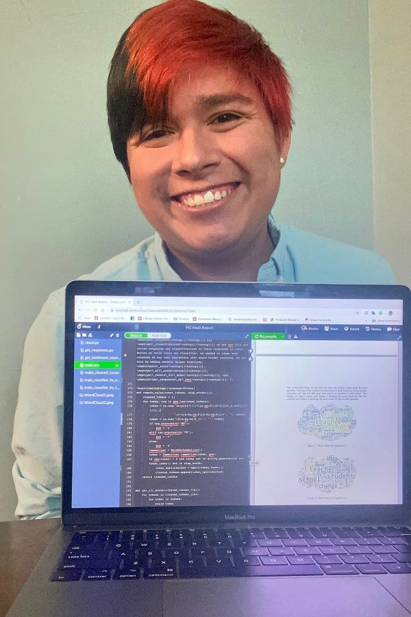 Jesus Carrera '20, a math major from Waco, Texas, poses with his laptop open to an app called Overleaf and his team's final presentation to the Lewiston public schools.