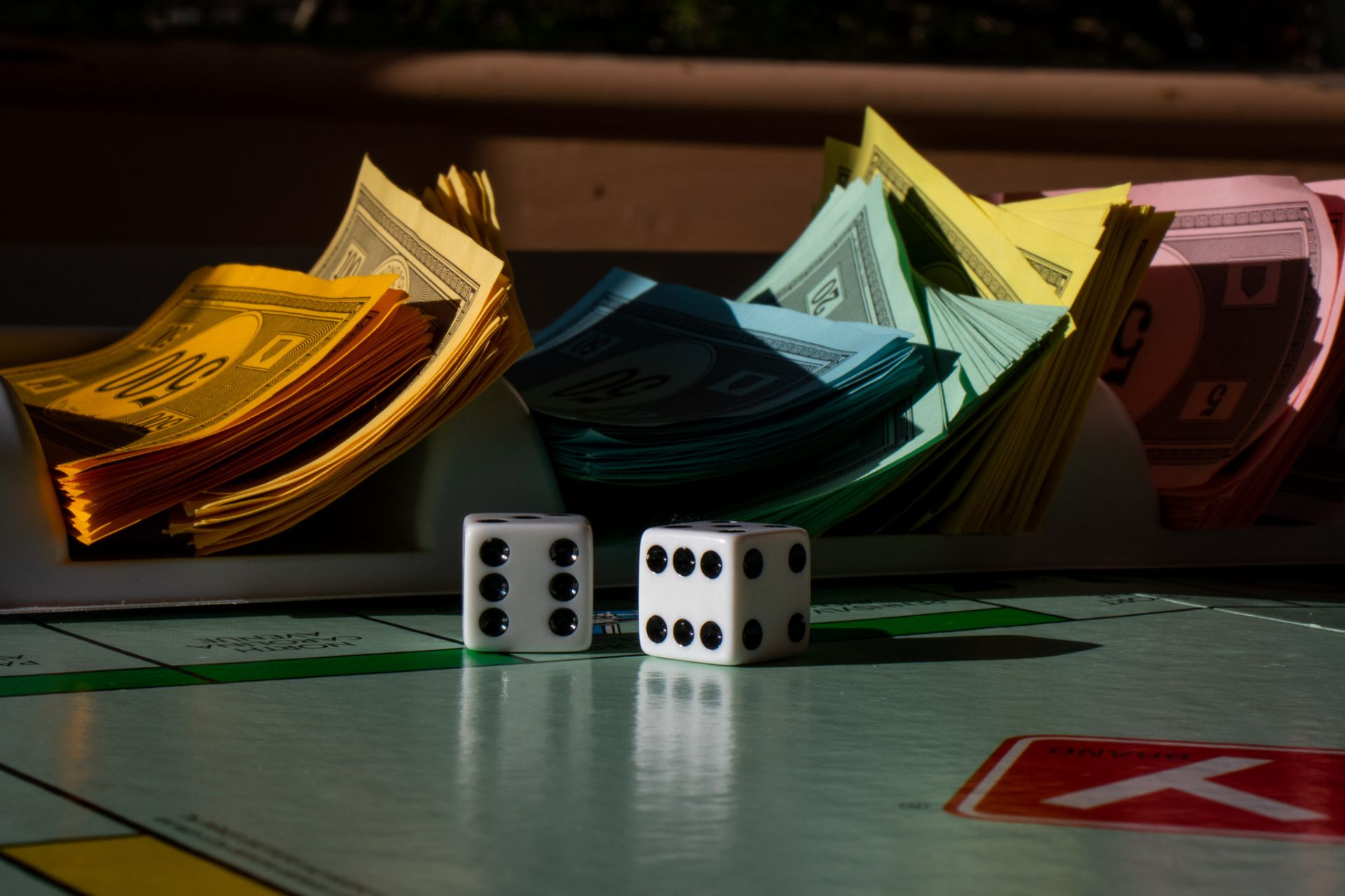 Money and dice sit on a Monopoly board on April 1, 2020. (Photograph by Cecely Sterling-Maisel '23)