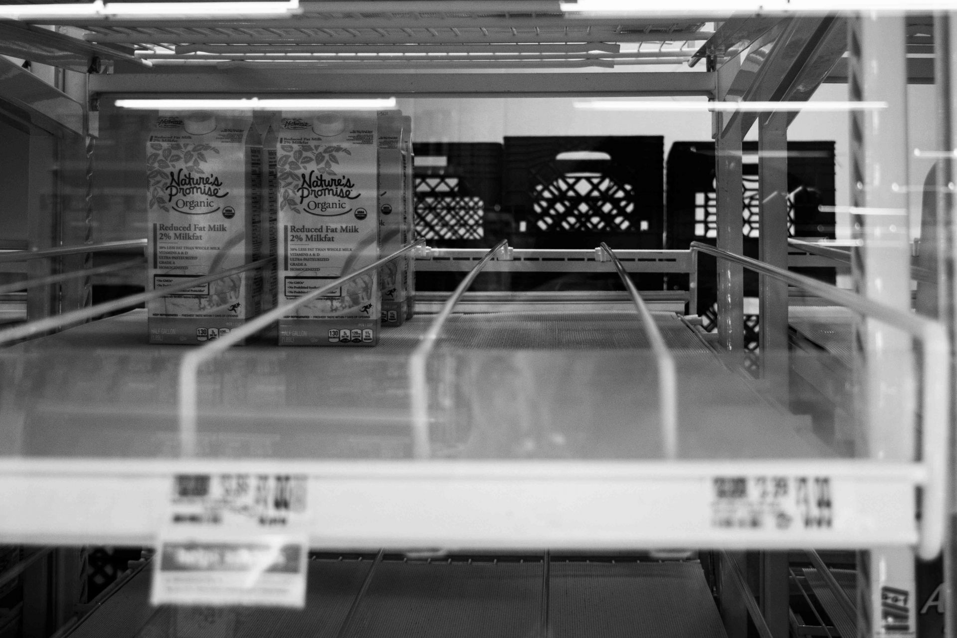 Cartons of milk run low in the dairy section of a Hannaford supermarket in Yarmouth, Maine, on April 11, 2020. (Photograph by Jenna Beagle '22)