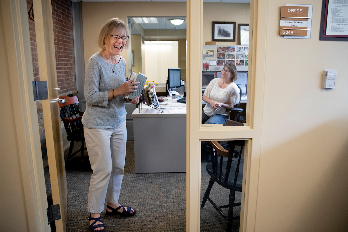 Costlow shares a moment with Academic Administrative Assistant Jeanne Beliveau in Beliveau's Hedge Hall office at the start of the fall 2019 semester. (Phyllis Graber Jensen/Bates College).