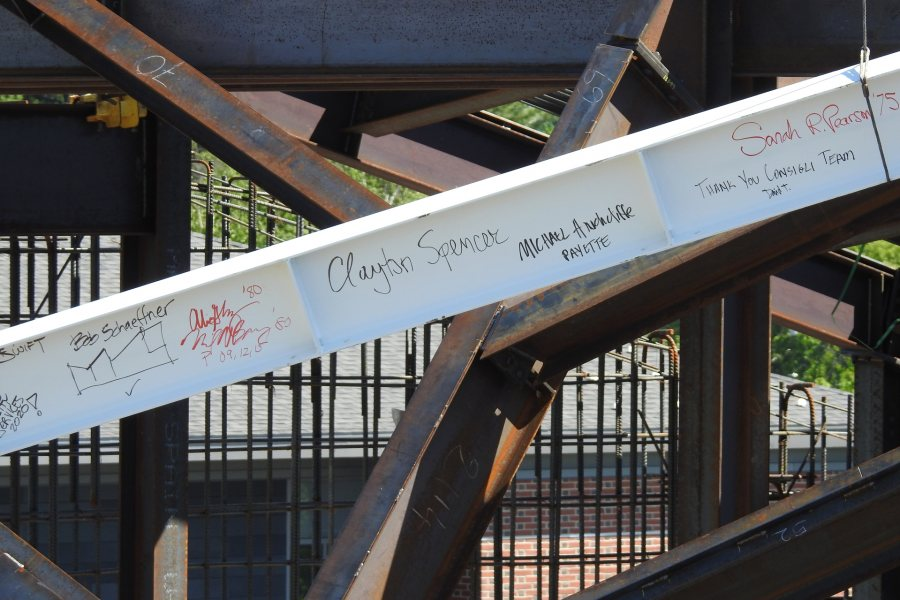 Signatures on the beam, now set in place. (Jay Burns/Bates College)