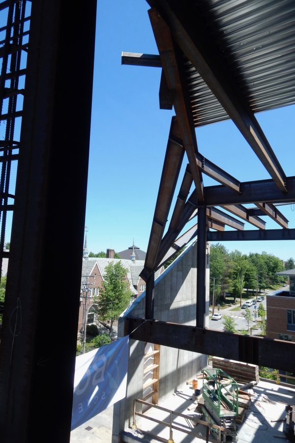 About two hours before the event, here's the location of the final beam for the Bonney Science Center, placed on June 16 at the topping-off celebration: The beam will slant from the flanges at top center to the junction of steel and concrete  toward the bottom. (Doug Hubley/Bates College)