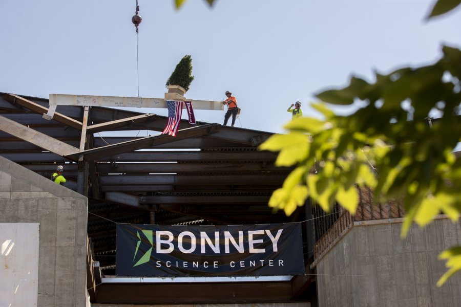 Images from the topping off event on May 16, 2020, at the Bonney Science Center, featuring the final major piece of structural steel being installed on the building. In keeping with tradition, a small spruce tree was attached to the beam fluttered plus a Bates banner and the American flag. The beam has the signatures of Bates participants and members of the Consigli construction crew.Participants: Michael W. Bonney '80, P'09, P'12, P'15Alison Grott Bonney '80, P'09, P'12, P'15Sarah R. Pearson '75, Vice President for College AdvancementA. Clayton Spencer, PresidentChris Streifel, Facilities Services Project ManagerGeoff Swift, Vice President for Finance and Administration and TreasurerPam Wichroski, Director of Capital Planning and ConstructionDave Thomas, Consigli Construction Michael Hinchcliffe, Payette Architecture Firm Bob Schaeffner, Payette Architecture Firm