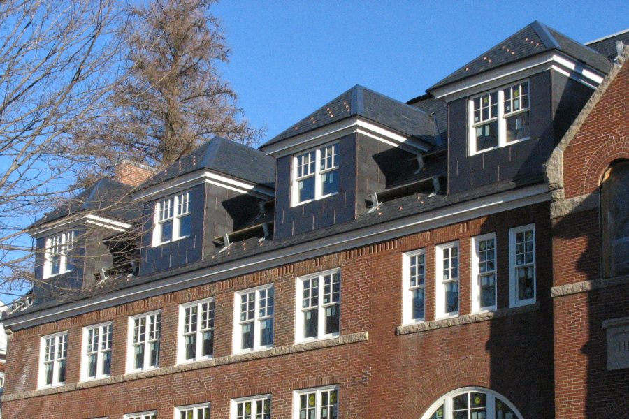 """This January 2011 image shows Revere Copper's """"Continental Bronze"""" cladding newly installed on the roof and dormers of Hedge Hall. (Doug Hubley/Bates College)"""