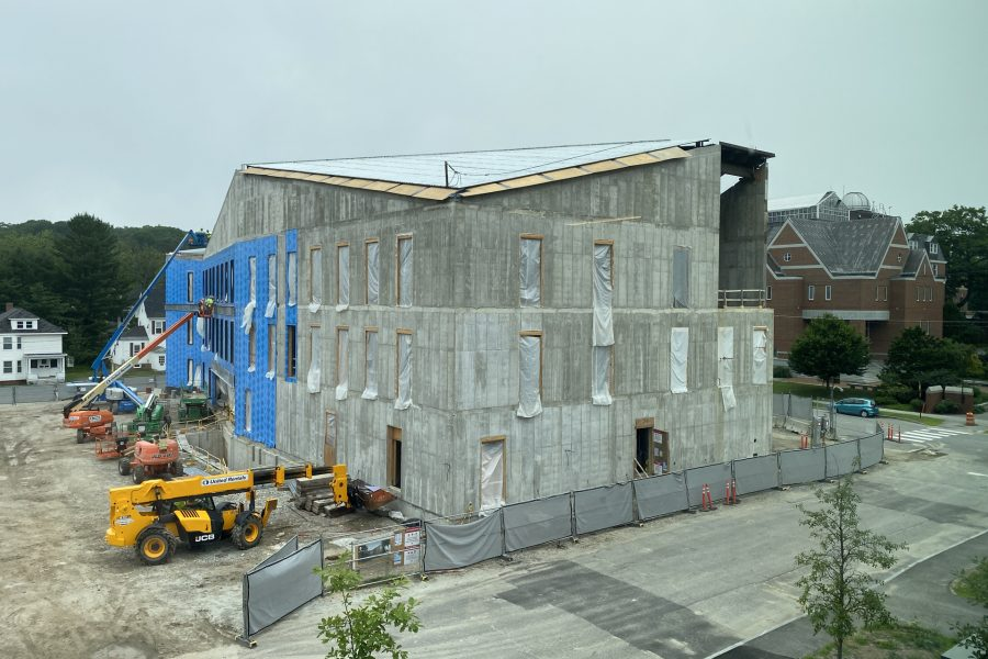 Seen from the third floor of Chu Hall, this July 10 view of the Bonney Science Center shows completed roof decking and, on the south wall, blueskin vapor barrier being applied. (Geoff Swift/Bates College)