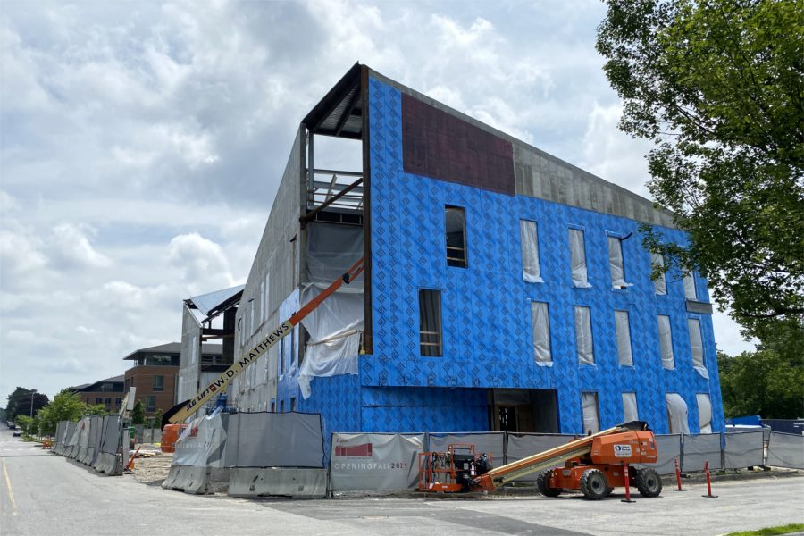 This July 10 view from Campus Avenue at Nichols Street shows the progress of blueskin application around the Bonney center. (Geoff Swift/Bates College)