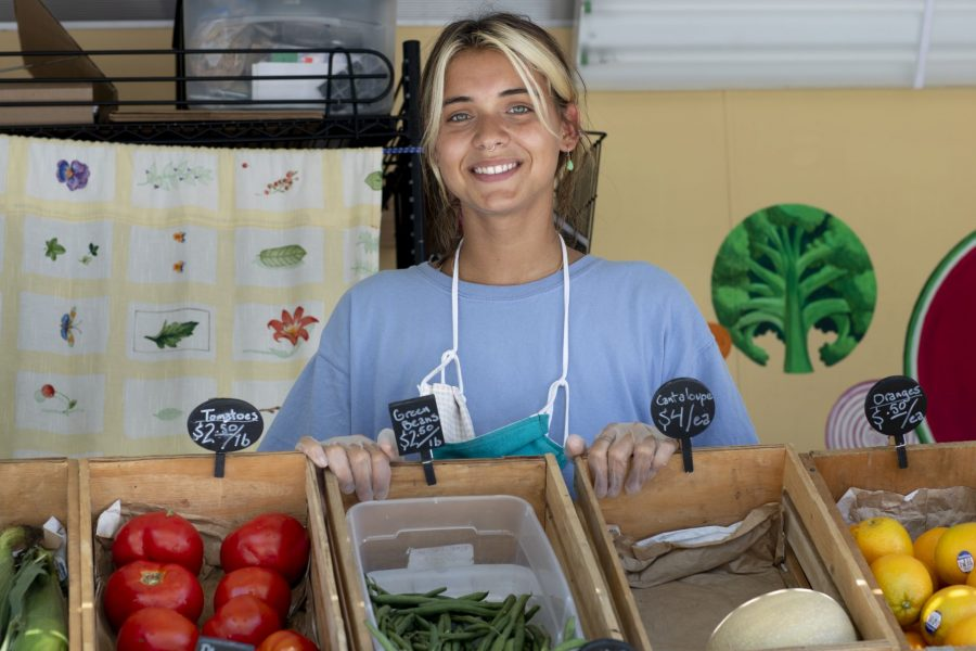 """""""Living and working in the Lewiston community has taught me a lot about what it really means to invest in the place one calls home because I've had the opportunity to work so closely with individuals who have committed themselves to connecting community members to food, land, and each other.""""  —Religious studies major Anna Maheu '21 of New York City, photographed on Campus Avenue with the Good Food Bus, a mobile market that brings locally sourced produce to various neighborhoods.  Maheu's Harward Summer Civic Fellowship with the Nutrition Center is funded through the Harward Center for Community Partnerships @harwardcenter.  A food security organization for food insecure and otherwise vulnerable families, the Nutrition Center's integrated programs include urban community gardens, children's gardening and cooking programs, cooking and nutrition education programs, youth leadership programs, food access initiatives, and a food pantry.  Maheu's work this summer consists of supporting the Nutrition Centers various gardens throughout Lewiston-Auburn, maintaining educational gardens, assisting the food pantry in its efforts to adapt to COVID-19 through food deliveries, and the Good Food Bus.  Maheu's hands-on experience, coupled with support provided by the Nutrition Center's staff members, has provided her with a """"ground-level look at the myriad ways that food justice and access is pursued,"""" she says, and """"has reaffirmed how fundamental food and soil are to the lives we live, the power structures we must work against, and the relationships we cultivate.""""  Thanks to the Nutrition Center, she also has had the chance to grow much of her own food this summer. """"I will take these sustaining and sustainable capacities with me into my life after Bates."""""""