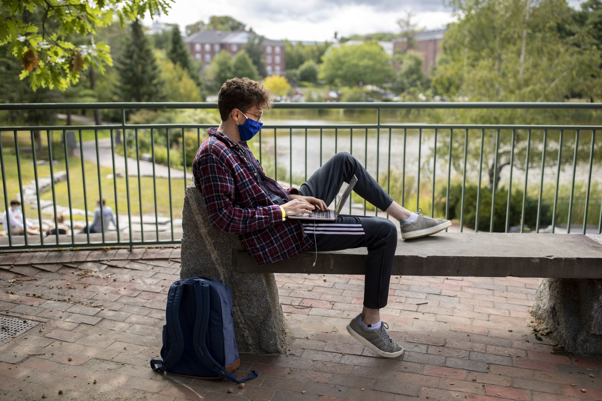 The Bates campus on and around Lake Andrews on Sept. 1, 2020, the day before classes start.   Brian Boitnot '21 Hanover, N.H., prepares for classes on the Olin Terrace.