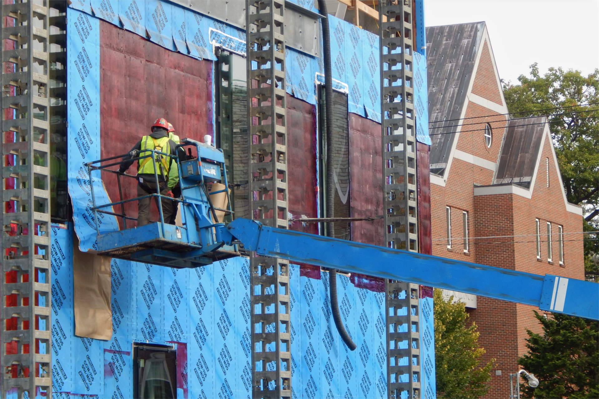"Applying ""blueskin"" moisture barrier on the Bardwell Street side of the Bonney building. (Doug Hubley/Bates College)"