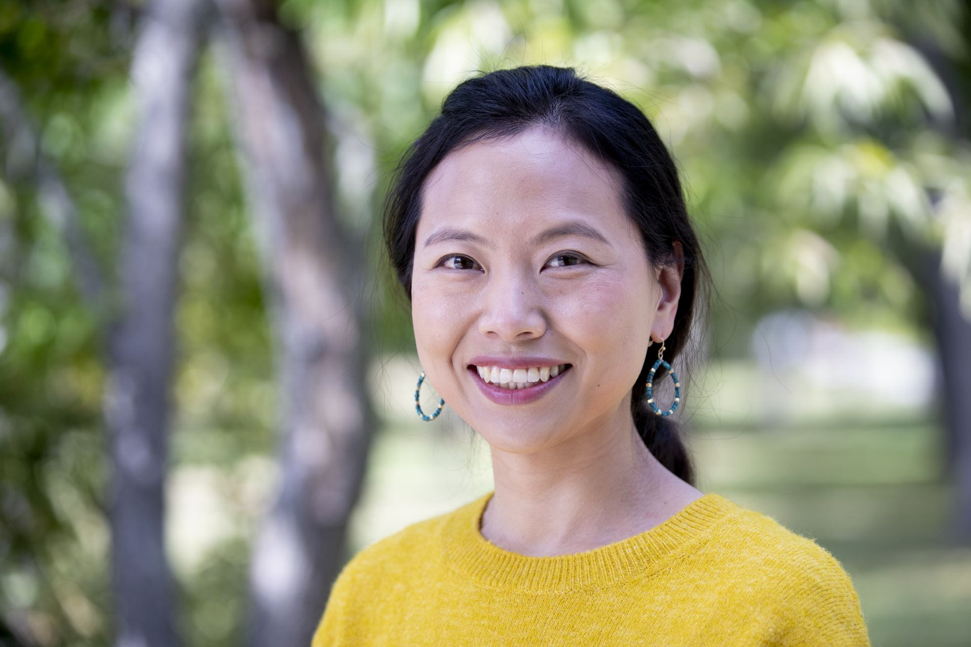 """Assistant Professor of PsychologyYunkyoung """"Yun"""" Garrison poses for a portrait on the edge of the Bates campus across from Lindholm House on Campus Avenue on Sept. 10, 2020"""