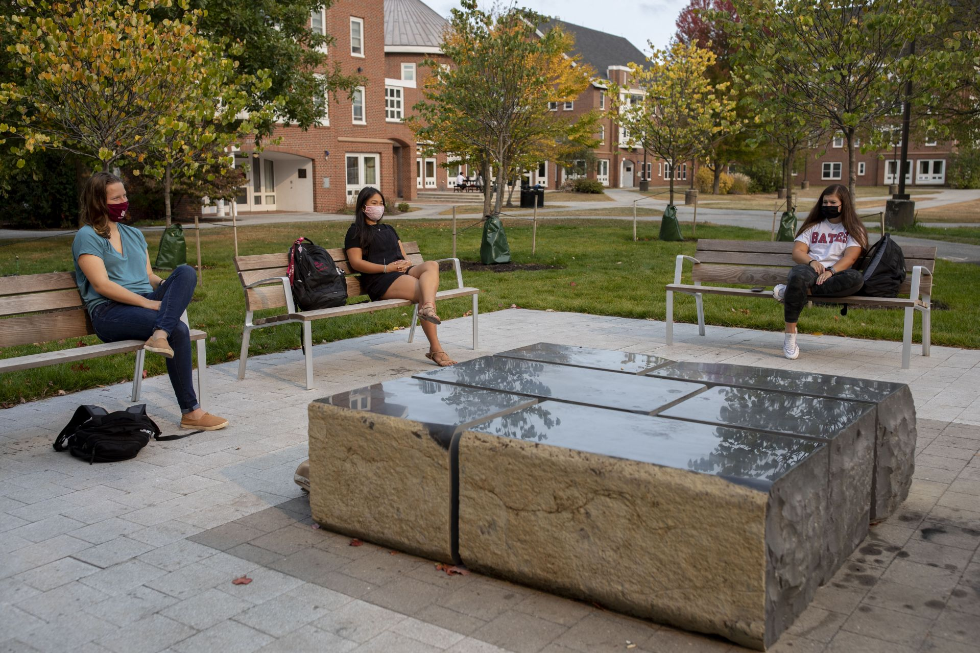 Sunday afternoon, Sept. 27, 2020, at or adjacent to the Veterans Plaza.  Janell Sato '22 of Honolulu, Hawaii, in black shirt, sits in reflection with friends Amanda Taylor '23 of Fair Lawn, N.J. (Bates shirt), Mary Colette '21 (blue shirt)  of Watertown, Conn., and Michael Ratsimbazafy '22 of Elizabeth, N.J., on the Veterans Plaza.