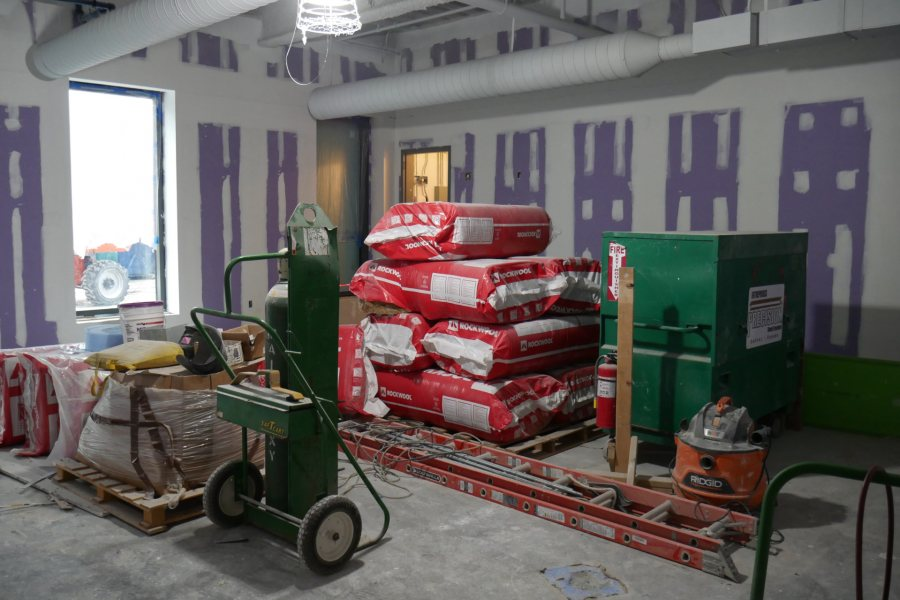 A first-floor classroom in the new science center serves for the moment as a storage area for wall insulation. (Doug Hubley/Bates College)