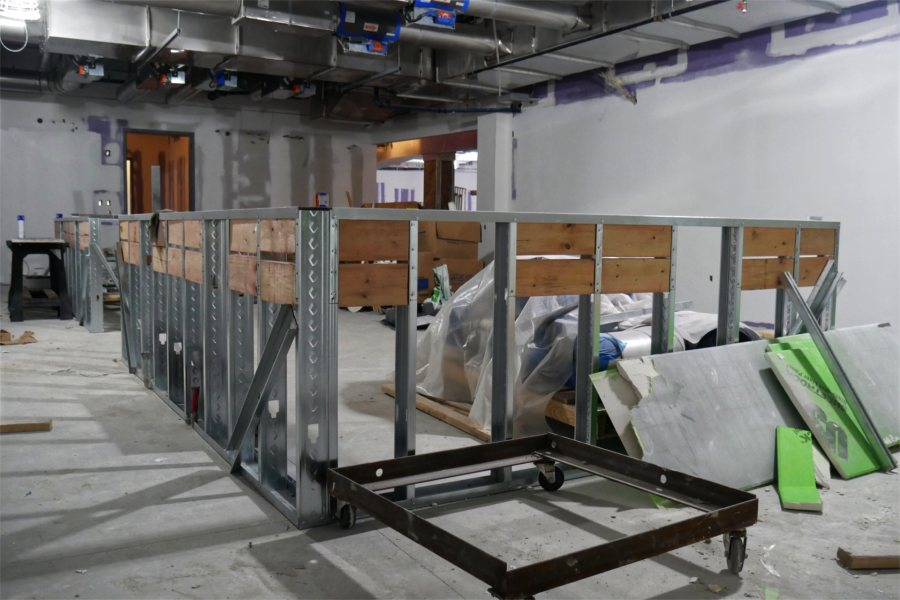In this biochemistry classroom, the metal framework will be the basis of a counter where students will sit for lab briefings. Once briefed, they'll go to their lab stations around the perimeter. (Doug Hubley/Bates College)