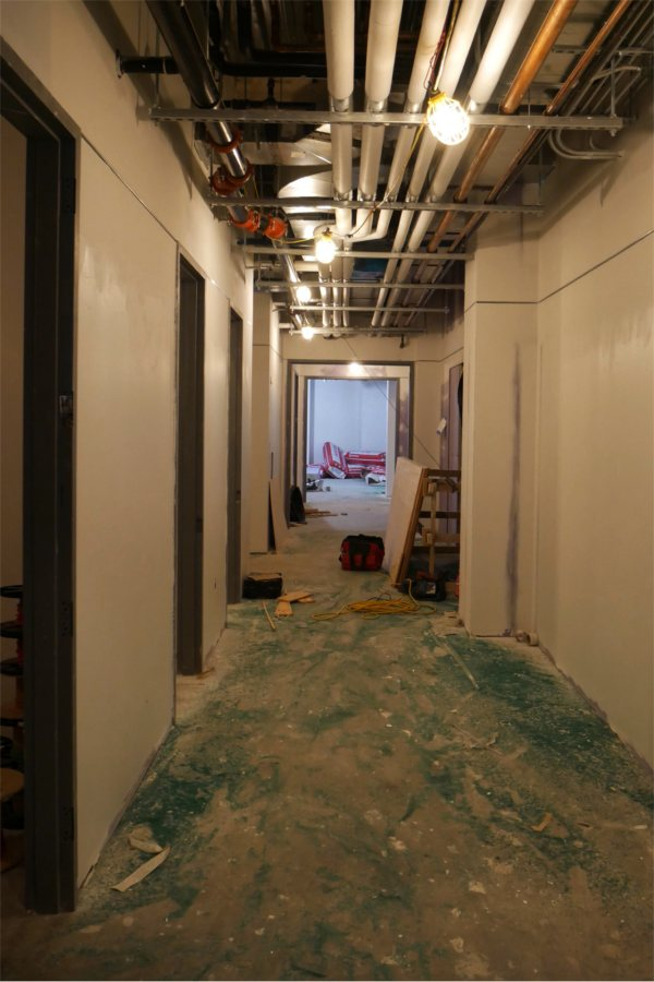 This first-floor corridor leads through a section of storerooms. The green stuff on the floor is sweeping compound. (Doug Hubley/Bates College)