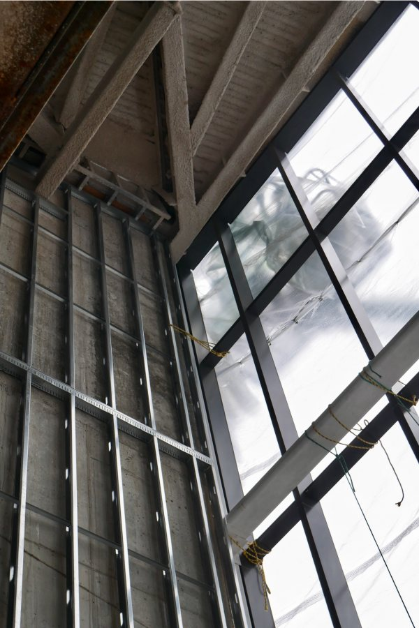 And here's the inside of the Beacon, with the plastic weather shield back in place. The silvery metal at left is wall studs and the dark metal will support window glass. (Doug Hubley/Bates College)