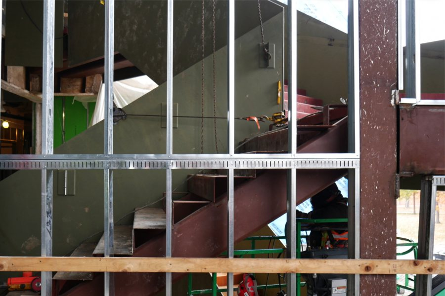 The Monumental Stairs are shown through wall studs on the second floor. The steel steps will be topped with polished concrete stairtreads. (Doug Hubley/Bates College)