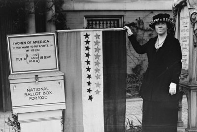HEC/29600/29676a.tifWomen of America! If you want to put a vote in in 1920 put a (.10, 1.00, 10.00) in now. National Ballot Box for 1920Harris & Ewing, photographer. Women of America! If you want to put a vote in input a .10, 1.00, 10.00 in now. National Ballot Box for. United States United States, 1920. Photograph. https://www.loc.gov/item/2016884625/.