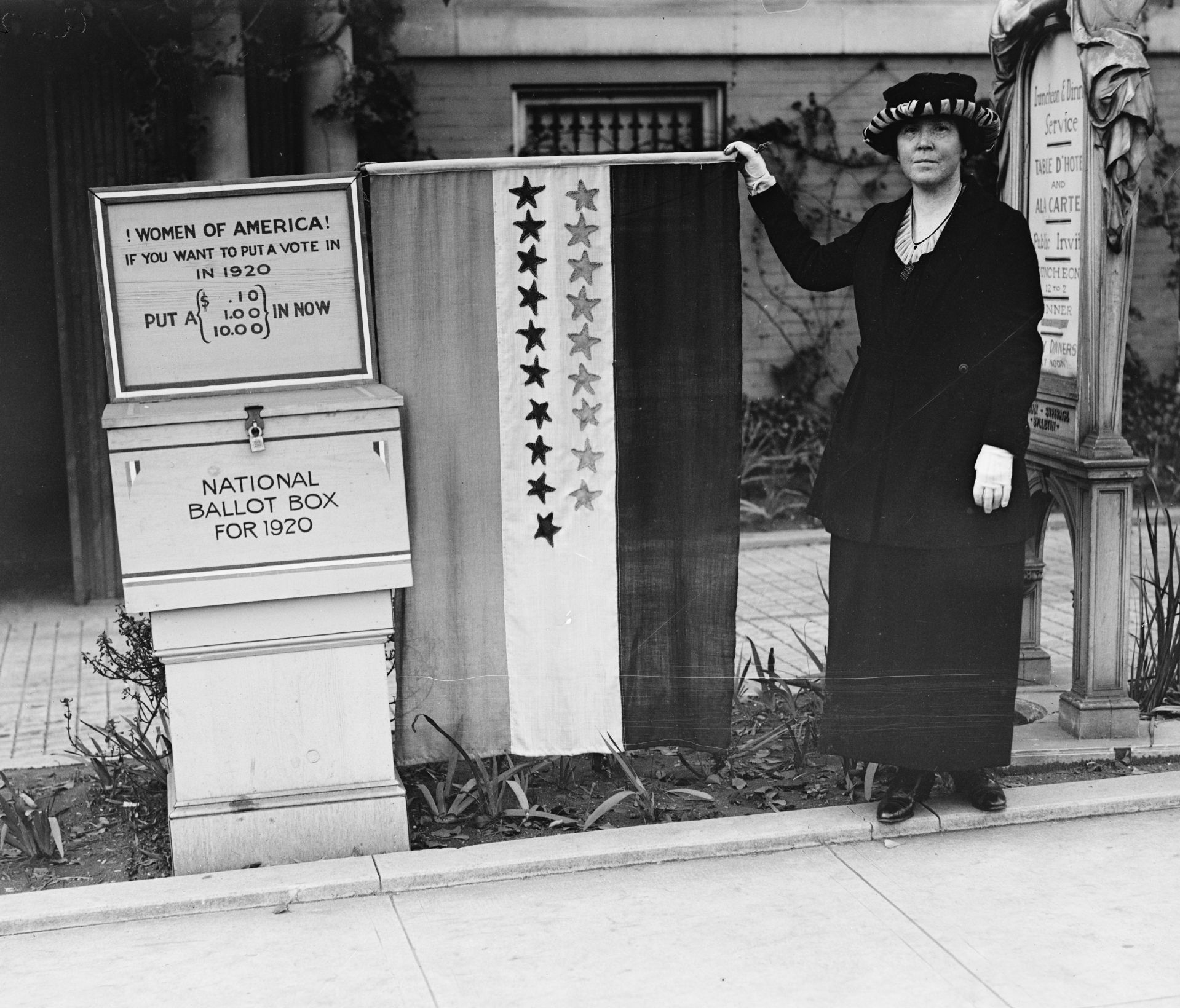 HEC/29600/29676a.tif  Women of America! If you want to put a vote in in 1920 put a (.10, 1.00, 10.00) in now. National Ballot Box for 1920  Harris & Ewing, photographer. Women of America! If you want to put a vote in input a .10, 1.00, 10.00 in now. National Ballot Box for. United States United States, 1920. Photograph. https://www.loc.gov/item/2016884625/.