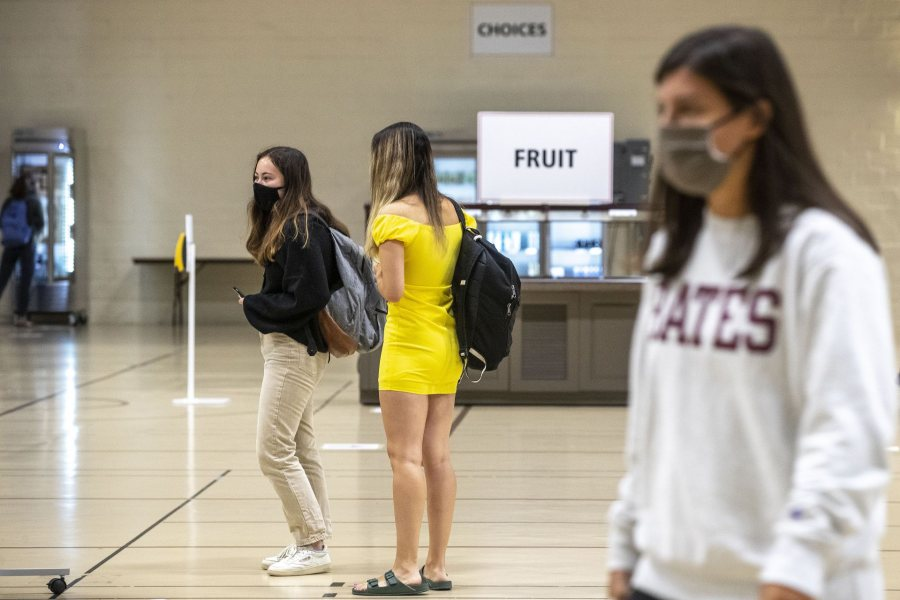 Students arrive at the Clifton Daggett Gray Athletic Building for Dash lunch at noontime on Oct. 5, 2020.