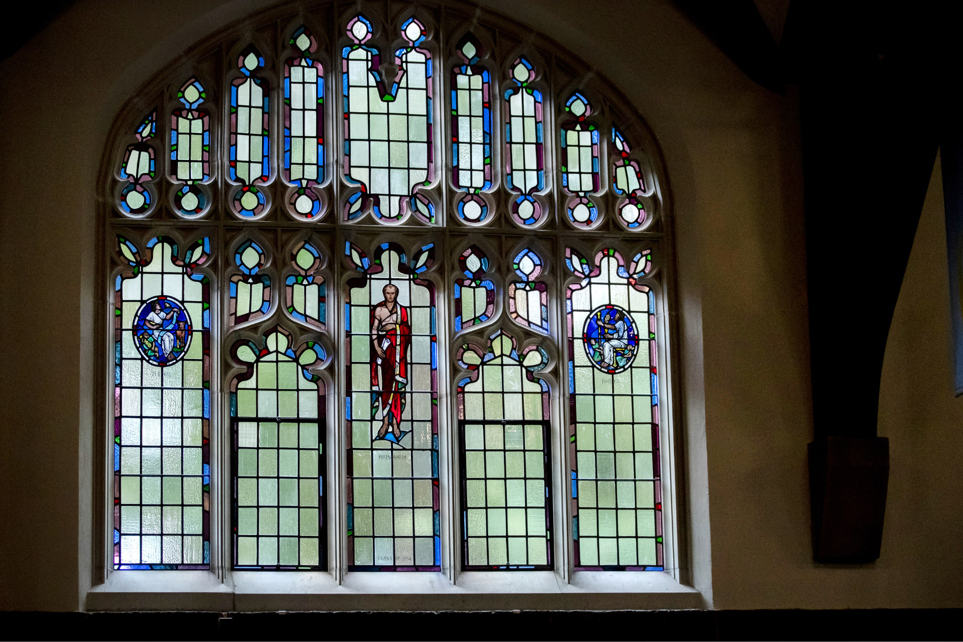 Brilliant restored images of Virgil, Aristotle, and Homer look on during a reopening ceremony for the Peter J. Gomes Chapel on Sept. 2, 2020. (Phyllis Graber Jensen/Bates College)
